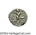Ancients:Greek, Ancients: Bruttium, Kaulonia. Ca. 475-?425 B.C. AR stater (19 mm,7.95 g). Nude Apollo walking right, holding laurel branch in righth...