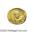 Ancients:Byzantine, Ancients: Justin I. A.D. 518-527. AV solidus (21 mm, 4.45 g).Constantinople, A.D. 519-527. Helmeted and cuirassed bust facingslightl...
