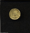 Ancients:Byzantine, Ancients: Justinian I. A.D. 527-565. AV solidus (21 mm, 4.28 g).Constantinople, A.D. 527-538. Helmeted and cuirassed bust facingslig...