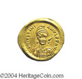Ancients:Byzantine, Ancients: Justinian I. A.D. 527-565. AV solidus (22 mm, 4.48 g).Constantinople, A.D. 527-538. Helmeted and cuirassed bust facingslig...