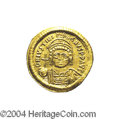 Ancients:Byzantine, Ancients: Justinian I. A.D. 527-565. AV solidus (20 mm, 4.34 g).Constantinople, A.D. 545-565. Helmeted and cuirassed bust facing,hol...