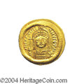 Ancients:Byzantine, Ancients: Justinian I. A.D. 527-565. AV solidus (21 mm, 4.50 g).Constantinople, A.D. 545-565. Helmeted and cuirassed bust facing,hol...