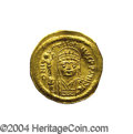 Ancients:Byzantine, Ancients: Justin II. A.D. 565-578. AV solidus (20 mm, 4.40 g).Constantinople. Helmeted and cuirassed bust facing, holding globesurmo...