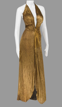 """Marilyn Monroe """"Lorelei Lee"""" gold pleated halter gown by Travilla worn during filming and promotion of Gentlem..."""