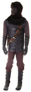 """Movie/TV Memorabilia, Foreground """"Gorilla Soldier"""" costume fromPlanet of the Apes...."""