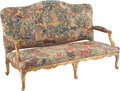Furniture, A French Régence Giltwood and Needlepoint and Petit Point Upholstered Settee, 18th century. 41-1/2 x 65 x 25-1/4 inches (105...