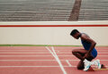 Photographs, Neil Leifer (American, 1942). Team USA's Carl Lewis kneeling on the track during a training session, 1988. Dye coupler. ...