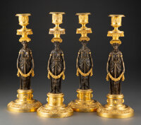 A Set of Four French Directoire Patinated and Gilt Bronze Candlesticks, circa 1795 13-1/4 x 4-3/4 x 4-3/4 inches (