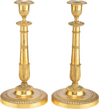 A Pair of French Empire Gilt Bronze Candlesticks, 19th century 12-3/4 x 6 x 6 inches (32.4 x 15.2 x 15.2 cm)  Property...