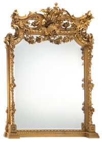 A Monumental American Rococo-Revival Carved Giltwood Over-Mantle Mirror, late 19th century Marks: FROM WILLARD & WOO...