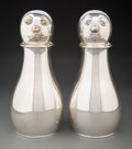 Silver & Vertu, Napier Company (American, est. 1922). Pair of Clown-Form Cocktail Shakers, circa 1945. Silver-plated brass. 12 x 5 x 5 i... (Total: 2 Items)