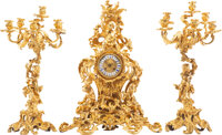 A Three-Piece French Louis XV-Style Gilt Bronze Clock Garniture with a Pair of Six-Light Candelabra 28 x 23 x 10-1/2 inc...