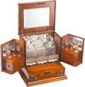 Furniture, A Continental Mahogany Cave à Liqueur with Three Cut-Glass Decanters, Six Cordial Glasses, and Three Metal Trays. 14-5/8 x 1...