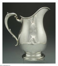 Silver & Vertu:Hollowware, AN AMERICAN SILVER PITCHER. Mark of Redlich, New York, c.1900. The baluster form body with shaped C-form handle, no monogr...
