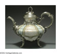 Silver & Vertu:Hollowware, A SILVER-MOUNTED FRENCH STONEWARE AND SILVER TEA POT. Maker unknown, c.1900. The multi-colored stoneware body with applied...