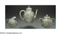 Silver Holloware, American:Tea Sets, AN AMERICAN SILVER THREE-PIECE FLORAL REPOUSSE TEA SET