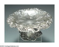 Silver & Vertu:Hollowware, AN AMERICAN SILVER BLACKBERRY PATTERN TAZZA. Mark of Tiffany, New York, c.1905. Clusters of blackberries with leaves and v...
