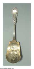 Silver Flatware, American:Wood & Hughes, AN AMERICAN SILVER GADROON PATTERN BERRY SCOOP