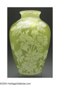 Glass, AN OVERLAID AND ETCHED GLASS VASE. Thomas Webb & Sons, c.1900. The yellow ground overlaid in ivory and finely etched to de...