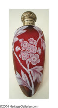 Glass, AN OVERLAID, ETCHED AND SILVER-MOUNTED GLASS PERFUME BOTTLE. The Glass: Thomas Webb and Sons, c.1890. The frosted red grou...
