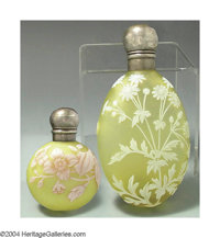 TWO OVERLAID, ETCHED AND SILVER-MOUNTED GLASS PERFUME BOTTLES The Glass: Thomas Webb and Sons, c.1890  The first, the fr...