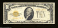 Small Size:Gold Certificates, Fr. 2400 $10 1928 Gold Certificate. Fine+.. The edges are ...