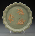 Ceramics & Porcelain, A Chinese Celadon Dish with Molded Phoenix, Yuan Dynasty. 5-3/4 inches (14.6 cm). ...