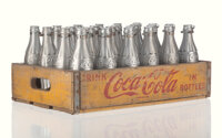 Andy Warhol (American, 1928-1987) You're In, 1967 Spray paint on glass bottles in printed wooden cra