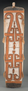 Tribal Art, An Asmat Painted Wood Shield With metal stand....