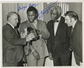 """Boxing Collectibles:Autographs, Joe Frazier Signed Photograph with Jackie Robinson. The Joe Fraziersigned 8x10"""" black and white photo depicts Joe Frazier,..."""