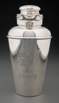 """Silver & Vertu, Whiting Manufacturing Company (American, est. 1840). """"Here's How"""" Cocktail Shaker, 1925. Silver. 9 x..."""