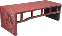 A Chinese Carved Red Lacquer Low Table 12-1/4 x 37-3/4 x 14 inches (31.1 x 95.9 x 35.6 cm)
