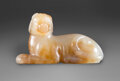 Carvings, A Chinese Russet Jade Dog. 1 x 2 x 0-1/2 inches (2.5 x 5.1 x 1.3 cm). ...