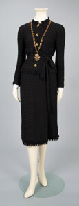 Textiles, A Coco Chanel Two-Piece Black Wool Suit with Necklace. Label to suit: CHANEL. Size: 4-6. ...