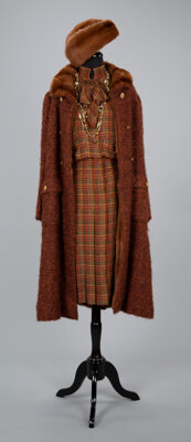 A Coco Chanel Bouclé Wool Mink-Lined Coat, with a Coco Chanel Two-Piece Wool Dress, Two Chanel Necklaces, and a M...
