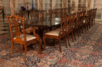 An English Sheraton-Style Pedestal Dining Table with Five Leaves with Eighteen Dining Chairs 30-1/4 x 214-1/2 x 48 inche...