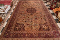 Textiles, A Tabriz Rug with Hunter's Motif, 19th century. 398 x 273 inches (1,010.9 x 693.4 cm). ...