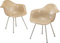Furniture, Charles Eames (American, 1907-1978) and Ray Kaiser Eames (American, 1912-1988). A Pair of Shell Arm Chairs with ...