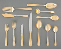 An Eighty-Two-Piece S. Kirk & Son Engraved Old Maryland Pattern Gilt Silver Flatware Service for Twelve, Baltimo...