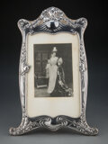 Silver & Vertu, A Dominick & Haff Art Nouveau Silver Picture Frame with a Portrait of a Woman, circa 1900. Marks: STERLING, (lozenge-cir...