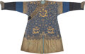 Textiles, A Chinese Blue Ground Bullion-Embroidered Silk Dragon Robe, Qing Dynasty. 57 x 90 inches (144.8 x 228.6 cm). PROVENANCE: ...
