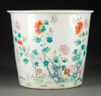 A Chinese Famille Rose Jardinière Marks: six-character Qianlong mark 8-3/4 x 9-1/4 inches (22.2 x 23.5 cm)