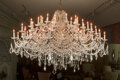 Lighting, A Large Gilt Bronze and Crystal Chandelier. 64 inches (162.6 cm) (diameter). ...