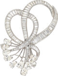Jewelry, A Diamond and Platinum Brooch. Stones: Pear-shaped diamonds weighing a total of approximately 8.50 carats; baguette...