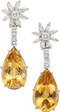 Jewelry, A Pair of Tiffany & Co. Topaz, Diamond, and Platinum Earrings. Stones: Pear-shaped orange topaz; marquise and full-cut diamo...