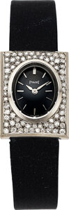 Jewelry, A Piaget Watch. Case: 22 x 17 mm, rectangle, 18k white gold, 3816 E 77520. Dial: Black dial, applied silver tone ...