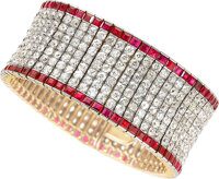 A Diamond, Ruby, and Platinum-Topped Gold Bracelet Stones: Old European-cut diamonds weighing a total of approximately 3...