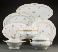 A One Hundred Forty-Two Piece Meissen Parcel Gilt Porcelain Scattered Flowers Pattern Table