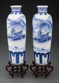 A Pair of Chinese Blue and White Porcelain Vases on Wood Stands 12 x 3-1/4 x 3-1/4 inches (30.5 x 8.3 x 8.3 cm)  ... (To...