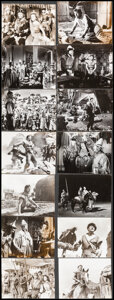 """Movie Posters:Action, The Conqueror (RKO, 1956). Fine/Very Fine. Photos (17) (Approx. 7.25"""" X 9"""", 7.5"""" X 9.5"""", & 8"""" X 10), Behind-the-Scenes Photo... (Total: 25 Items)"""